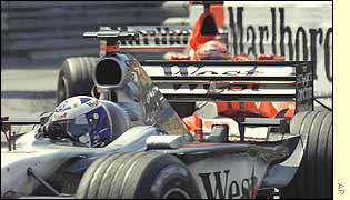 David Coultard holds off Michael Schumacher in the closing stages of the Monaco Grand Prix