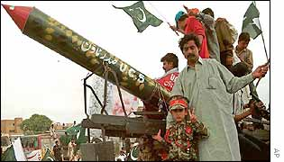Pakistanis celebrate the fourth nuclear testing anniversary in Karachi around a missile imitation