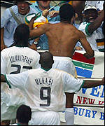 Quinton Fortune celebrates with the South Africa fans