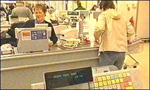 A shopper collects supermarket reward points