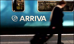 Passenger walks past an Arriva train