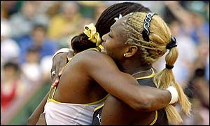 Serena Williams (right) embraces older sister Venus after winning the French Open