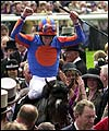 Winning jockey celebrates his Derby win on High Chaparral