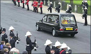 Queen Mother's funeral cortege leaves Westminster Abbey