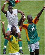 Senegal's Amara Traore carries Henri Camara on his shoulders with Papa Bouba Diop  (right)