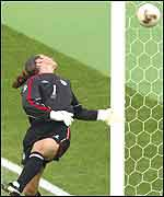 England keeper David Seaman watches Ronaldinho's speculative free-kick put the Brazilians 2-1 up