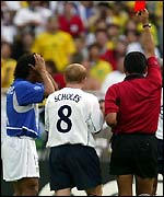 Ronaldinho reacts with disbelief as the referee shows him the red card