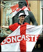 An England fan from Doncaster celebrates after a match