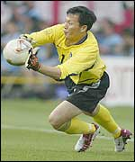 Lee Woon-Jae saves a crucial penalty in the shoot-out