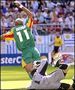 Diouf's wins a penalty during his team's match against Uruguay
