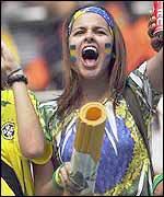 A Brazil fan celebrates