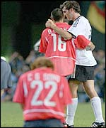 Germany's Christoph Metzelder puts a consoling arm around Cha Doo-Ri