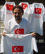 Ahmet Bulut selling T-shirts to the Turkish fans in London