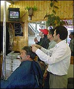 More staff than customers at the Jeylan barber