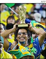 Brazil fan holds imitation World Cup
