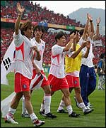 South Korea's players celebrate victory over Spain