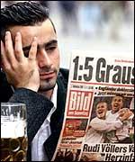 Man reading 5-1 newspaper