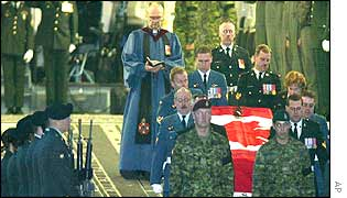Pall bearers carry the coffin of one those killed after arrival at Ramstein airbase in Germany on 20 April, 2002