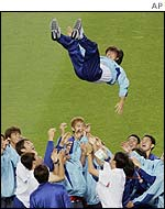 South Korea captain Hong Myung-Bo is thrown into the air by team-mates