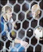 Italian referee Pierluigi Collina (right) attempts to console Oliver Kahn