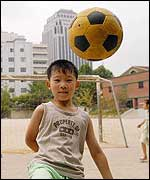 A Korean boy plays football during the World Cup in Seoul