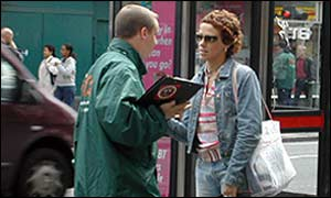 Talking to a passer-by in London