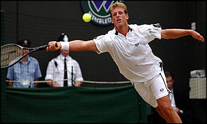 David Nalbandian stretches for a forehand against Xavier Malisse