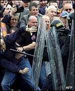 Protestors held back by police
