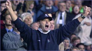 Clive Woodward celebrates a try for England