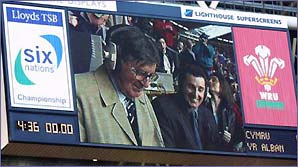 Bill McLaren and Jonathan Davies appear on the big screen in Cardiff
