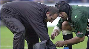 Richard Mack treats an injured London Irish player