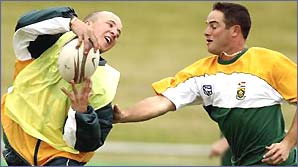 South African cricketers Boeta Dippenaar and Mark Boucher play a game of touch rugby