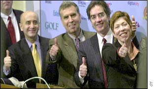 AOL Time Warner's management celebrate as the new company's shares debut on the New York Stock Exchange