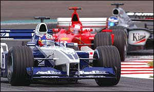 Juan Pablo Montoya, Michael Schumacher and Kimi Raikkonen early in the race