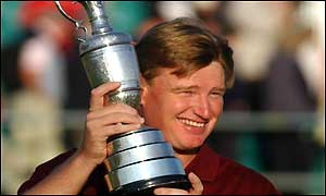 Ernie Els with the Championship Trophy on the 18th green