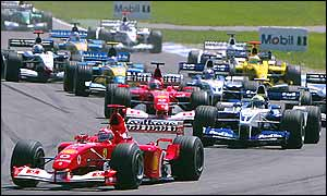 Michael Schumacher leads brother Ralf and Rubens Barrichello at the start of the German Grand Prix