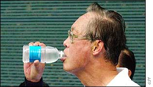 Singaporean Prime Minister Goh Chok Tong drinks chilled recycled waste water