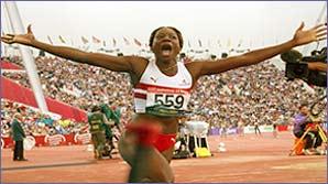 Ashia Hansen celebrates gold at the Commonwealths