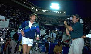 Jimmy Connors is engulfed by the media at the 1991 US Open
