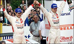 Loeb (right) celebrates with co-driver Daniel Elelena