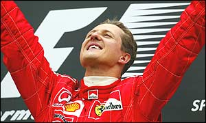 Michael Schumacher celebrates victory in the Belgian Grand Prix - a record 10th in a season