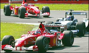 Rubens Barrichello moves into the lead of the Italian Grand Prix, starting a chain reaction of diaster for Juan Pablo Montoya, with Michael Schumacher close behind