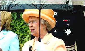 Queen holding an umbrella