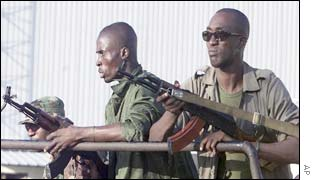 Soldiers escorting Ivorian President Laurent Gbagbo
