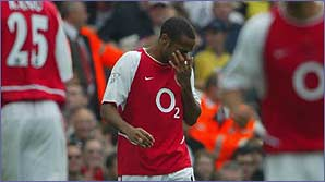 Thierry Henry hangs his head after missing