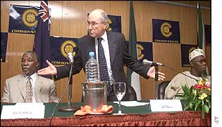 President Thabo Mbeki of South Africa, Prime Minister John Howard of Australia, and President  Olusegun Obasanjo of Nigeria