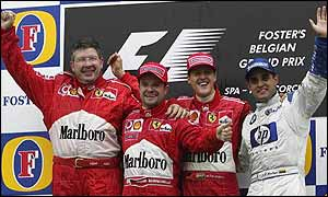 Ferrari technical director Ross Brawn joins drivers Rubens Barrichello and Michael Schumacher and Williams' Juan Pablo Montoya on the Belgian Grand Prix podium