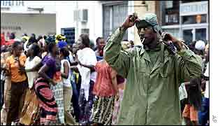 Ivorian rebel with anti-government demonstrators