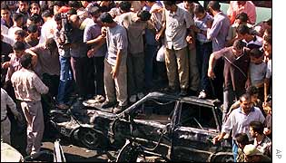 Palestinians gather at wreckage of bombed car