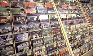 CDs lining the shelves in a music shop